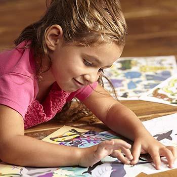 toddler enjoy a reusable sticker book